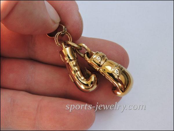 Golden gloves necklace